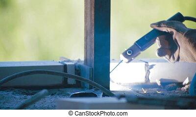 Worker Welding metal beam Construction site