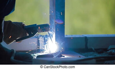 Worker Welding metal detail Construction site - Construction...