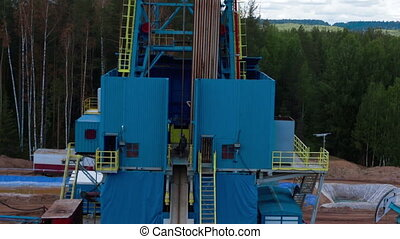 oil drilling tower aerial view petroleum-producing - Flying...