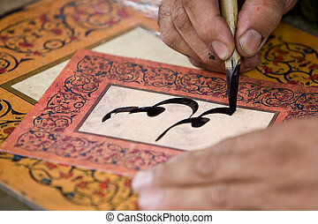 arab writing - a man writing a name with traditional arab...