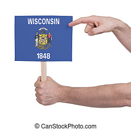 Hand holding small card - Flag of Wisconsin