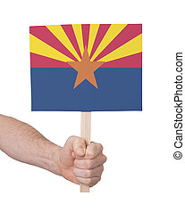 Hand holding small card - Flag of Arizona - Hand holding...