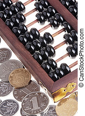 Old wooden Chinese Abacus and Chinese coins - Close up of an...