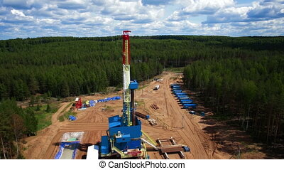 Aerial view oil gas drilling tower in forest - Aerial view...