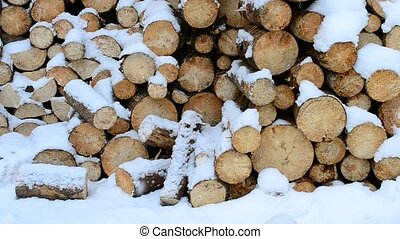 Snow falling beautifully on background of wooden logs - Snow...