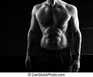 muscular handsome man isolated on black background - Close...