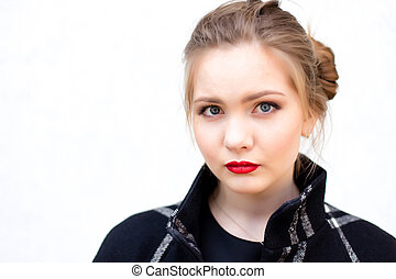 portrait of a girl in high key against a white wall