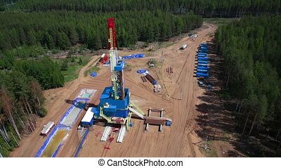 oil gas drilling tower in forest - Aerial view of the oil...