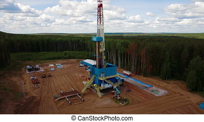 the oil gas drilling tower in forest - Aerial view of the...