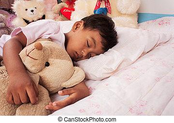 a little asian boy sleep with teddy bear