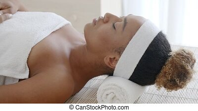 Young Female Relaxing In Spa Salon - Beautiful young african...