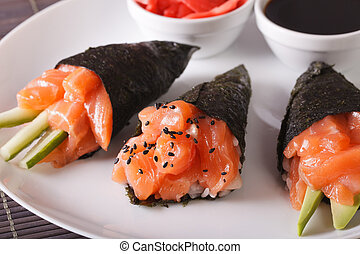 Temaki salmon on a plate close-up. horizontal - Temaki...