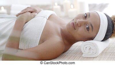 Woman Lying On A Lounger In A Wellness Center