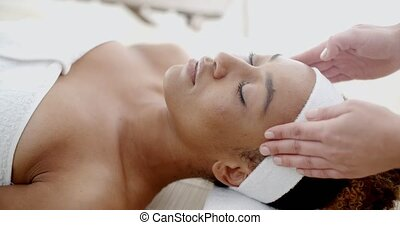 Woman Taking Head Massage - Young woman receiving a head...