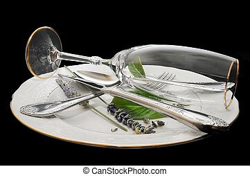 cutlery and crockery isolated on black background