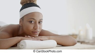 Woman Relaxing On A Pillow
