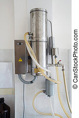 Vintage laboratory water distiller on the wall