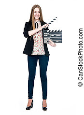 Beautiful smiling woman holding a movie clapper.