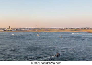 Boats and Airplanes in Boston Bay by Logan Airport