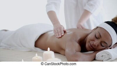 Back Massage On Woman - Female therapist's hands doing back...
