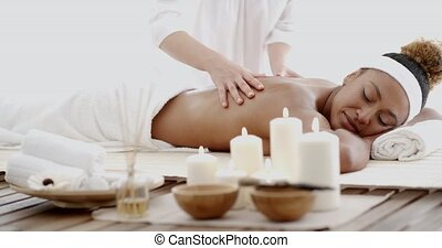 Young Woman Having A Massage In A Spa - Masseur doing...