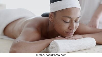 Woman Receiving A Massage With Hot Stone - African-american...