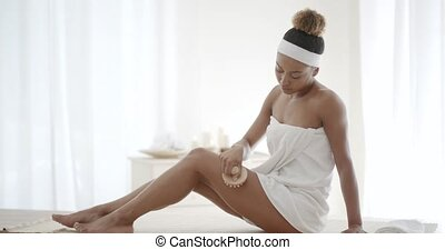 Young Woman Scrubbing Her Leg - Young woman scrubbing her...