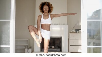 African Woman Doing Yoga At Home - Young beautiful woman...