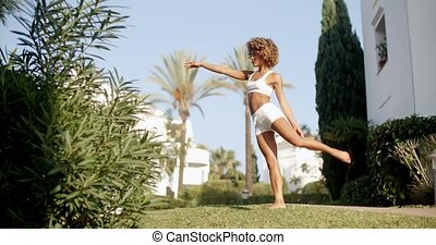 Fit Woman Working Out - Afro haired girl doing yoga on sunny...