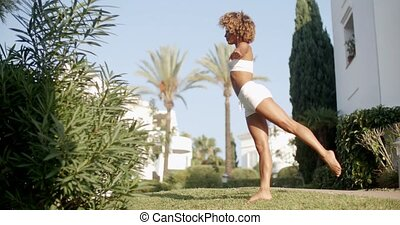 Woman Practicing Yoga Outside In Nature - Young healthy...