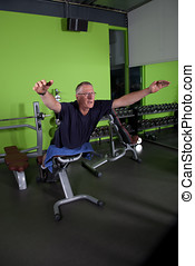 Back exercise - Senior man doing exercises to strengthen his...