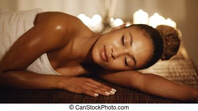Woman Relaxing In Spa Salon - Happy young woman lying in spa...