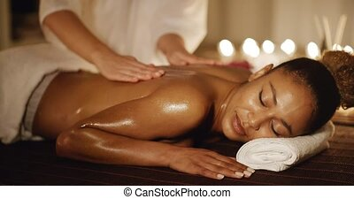 Woman Having Therapy Massage Of Back - African-american...
