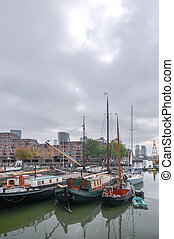 view at old boats on Rotterdam canal - view on old boats on...