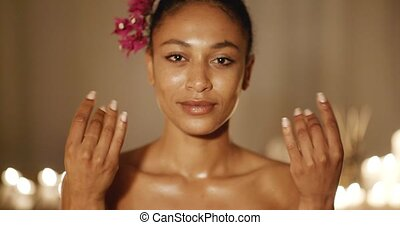 Woman Meditating In Spa - Woman folded his fingers for...