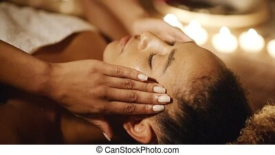 Young Woman Massaging Her Face - Young woman massaging her...