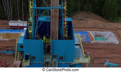 Flying over the oil drilling tower petroleum - Flying over...