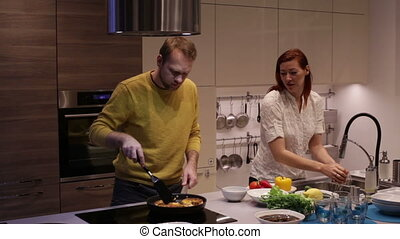 The husband and wife preparing dinner - Happy Couple On the...