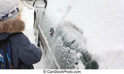 child and car in snow - Little boy and car in snow