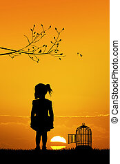 girl with bird cage at sunset