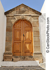 Old wooden door - Iconic mansion door in the village, Rhodos...