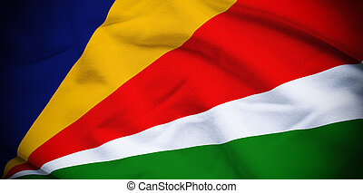 Seychelles Flag - Wavy and rippled national flag of...