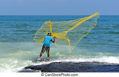 Throwing fishing net - Fisherman throwing yellow fishing net