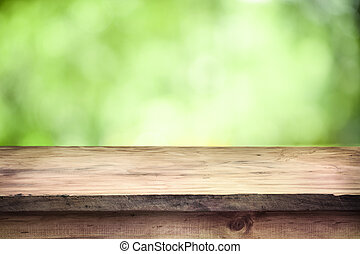 Space table top - Empty wooden deck table with green soft...