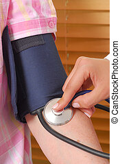 Check Up - Extreme close-up image of a blood pressure check...