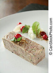 plated pork terrine starter with cranberries