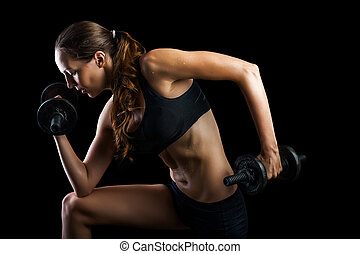 Work out with dumbbells on black background