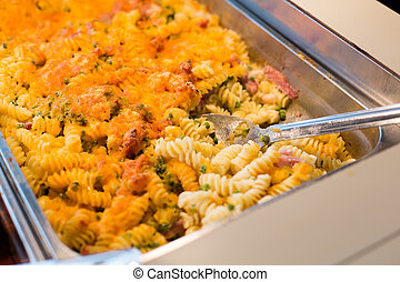 close up of pasta and spoon on catering tray - food,...