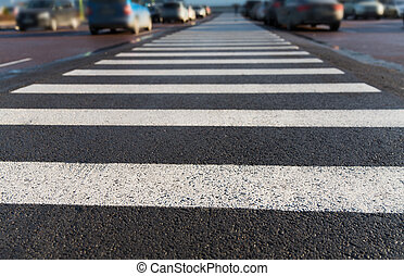 close up of pedestrian crosswalk on city parking - safety,...