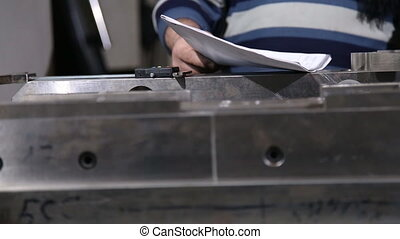 Worker the item is measured with a micrometer closeup